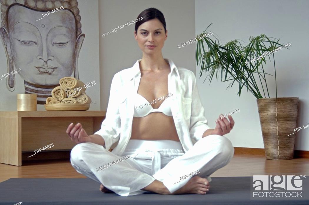 Stock Photo: Woman doing yoga exercise.