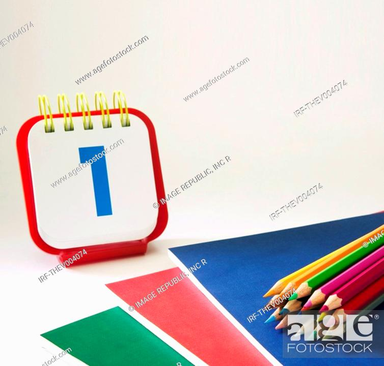 Stock Photo: pencils on the pile of notes and calender.