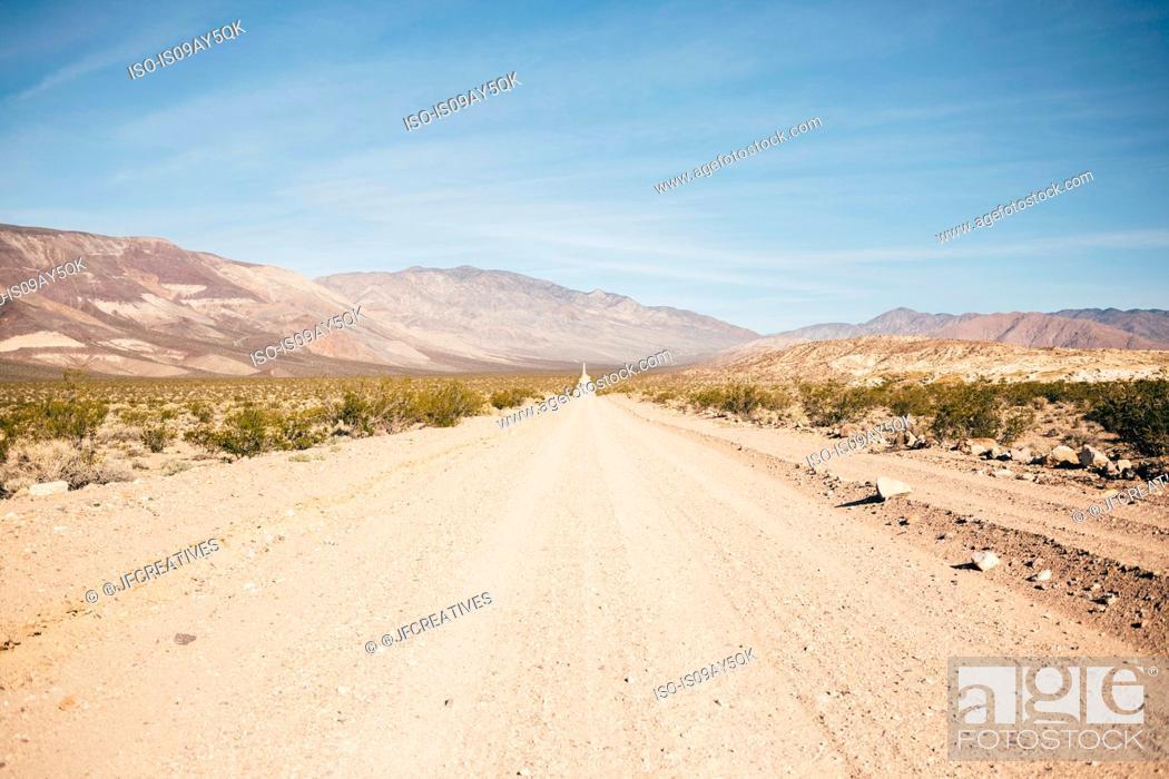 Stock Photo: Straight dirt track road in desert landscape, Olancha, California, USA.