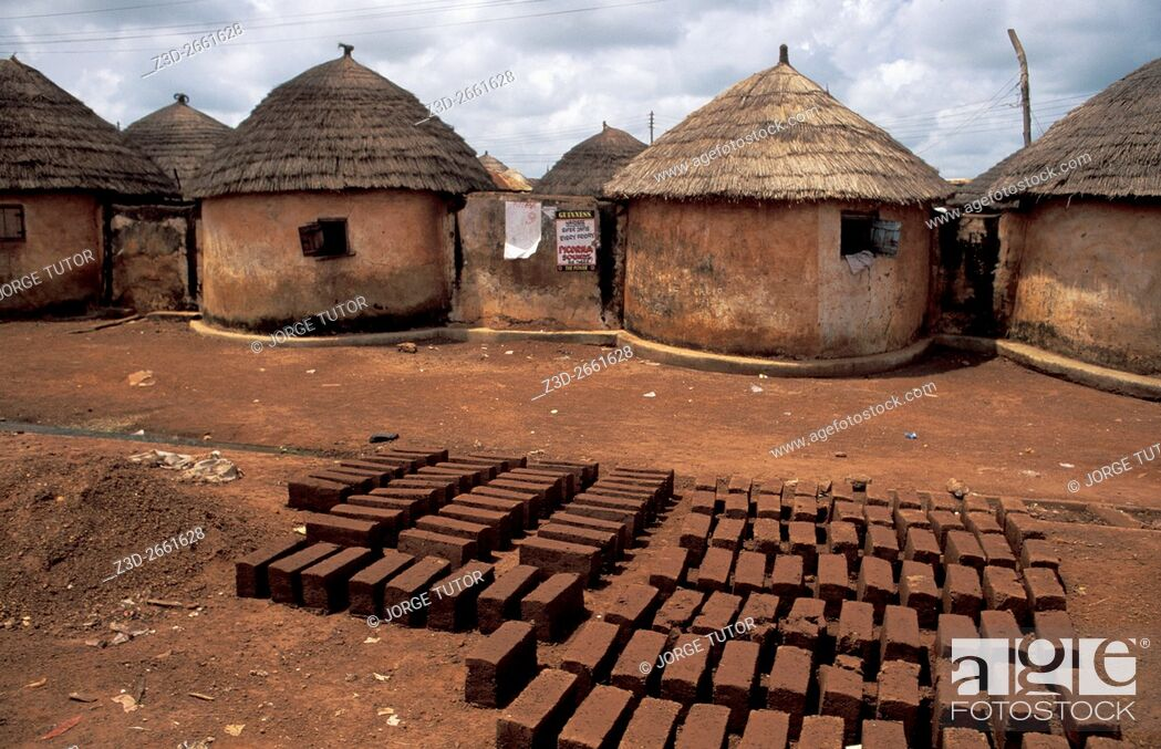 Stock Photo: Mud bricks near Thatched Mud huts village compound in Tamale, Ghana.