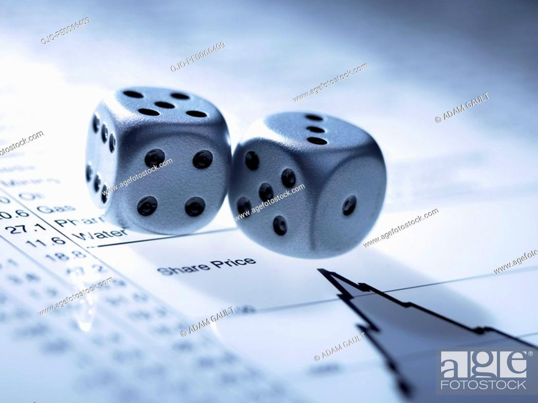 Stock Photo: Silver dice on list of share prices.