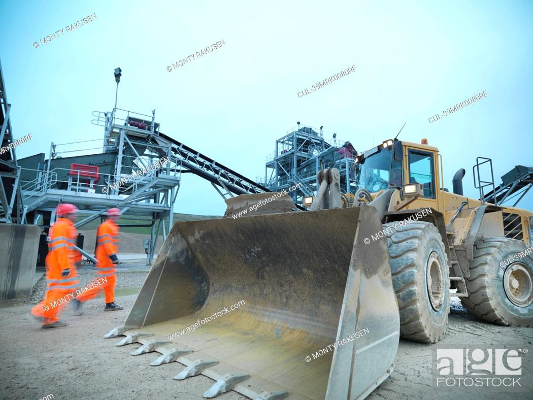 Stock Photo: Blurred view of workers walking on site.