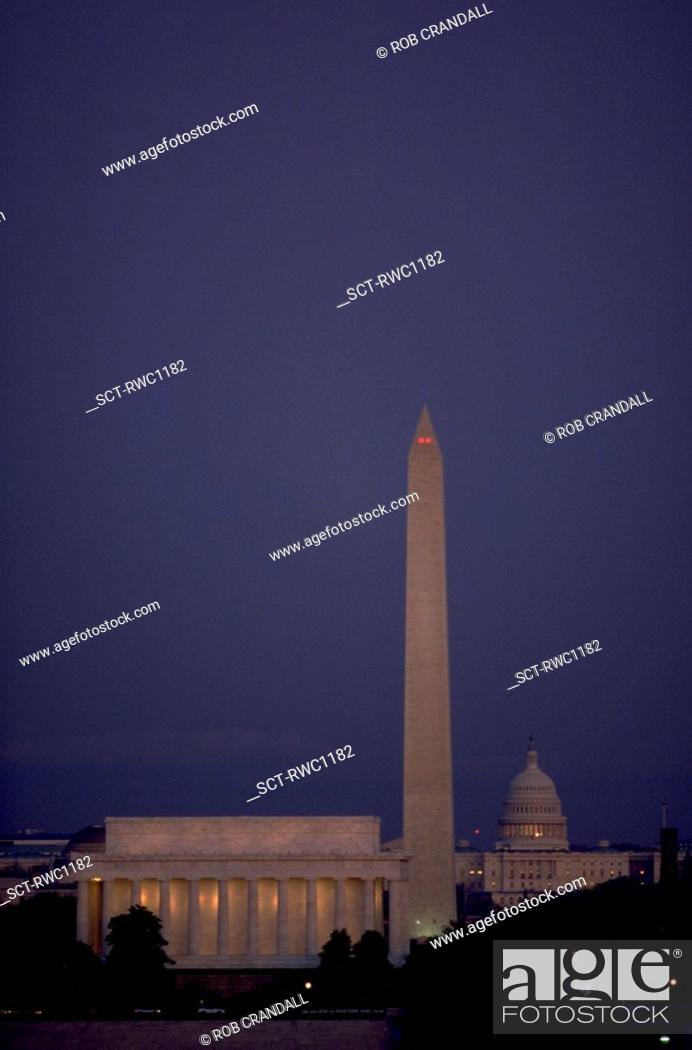 Stock Photo: View at dusk of the Lincoln Memorial, the Washington, Monument, and the United States Capitol dome (left to right) in Washington, DC.