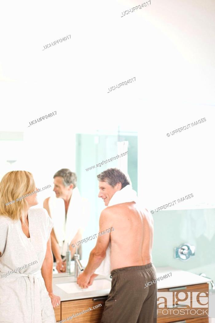Stock Photo: Couple in bathroom.