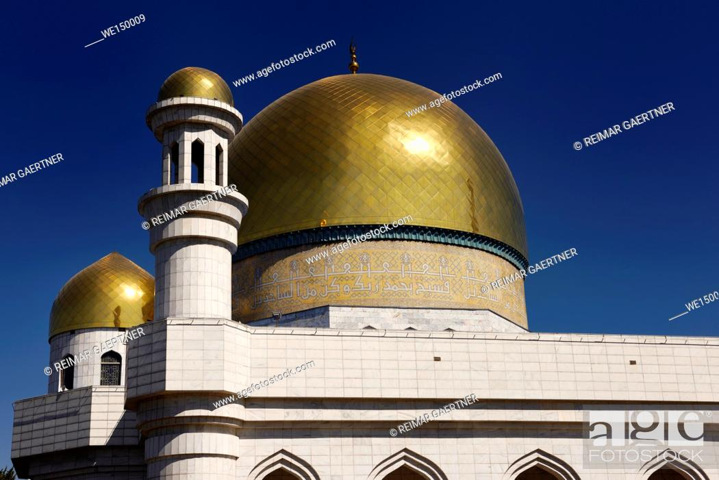 Stock Photo: Golden domes and Turkish caligraphy of Central Mosque in Almaty Kazakhstan.