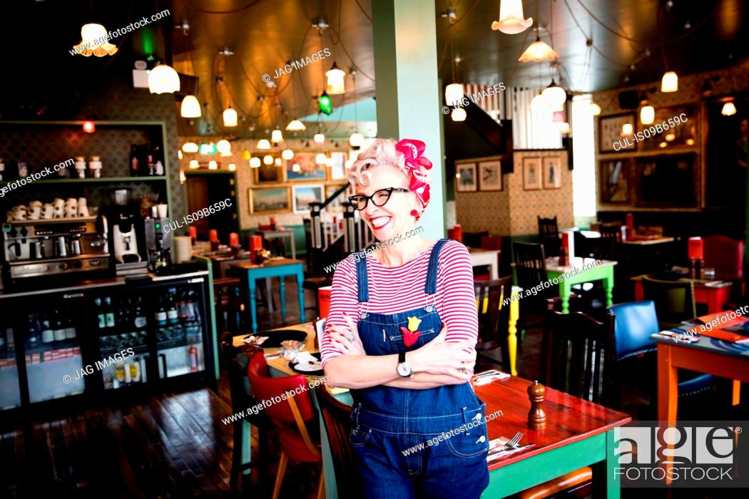 Stock Photo: Quirky woman in bar and restaurant, Bournemouth, England.