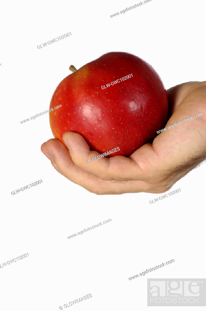 Stock Photo: Close-up of a businessman holding an apple.