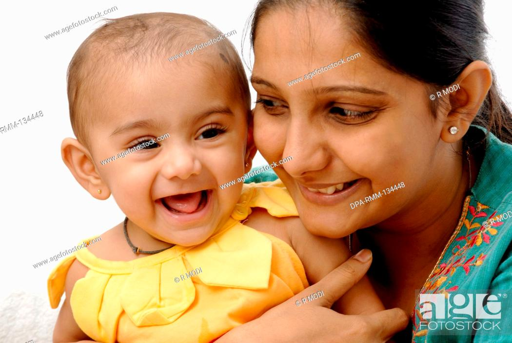 Indian Mother and child, happy, white background, India, MR