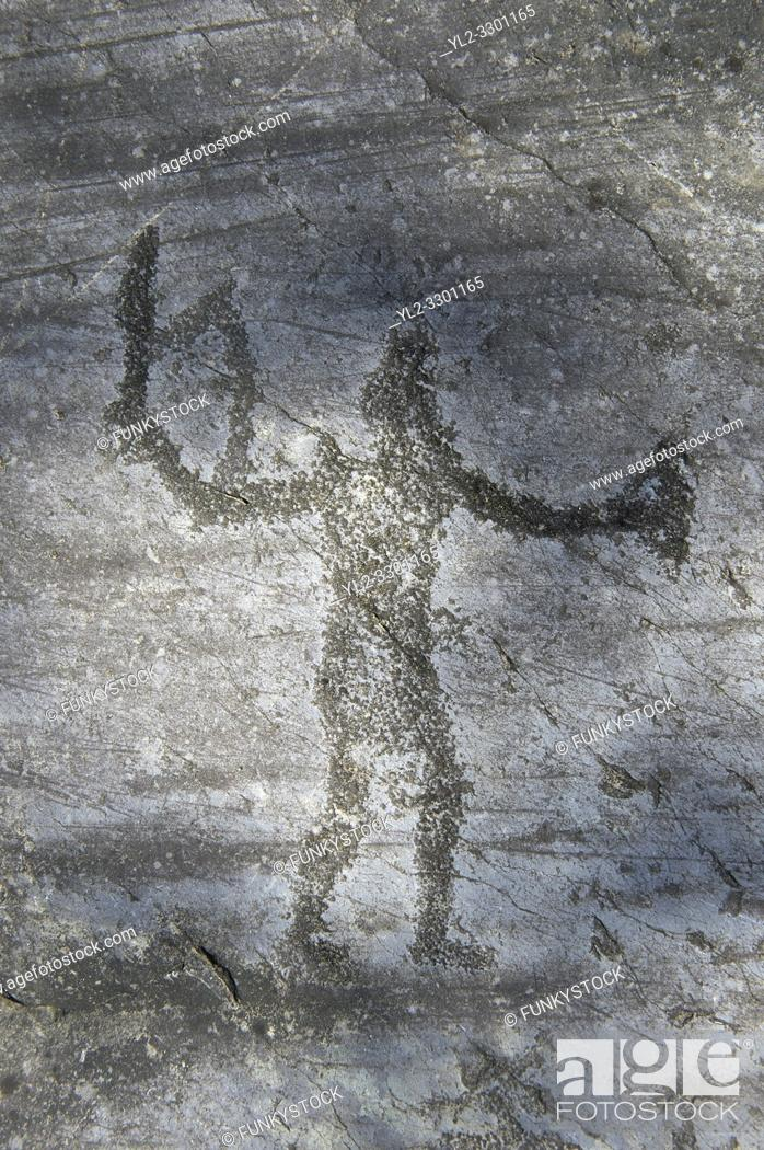 Stock Photo: Petroglyph, rock carving, of two feet outlines. Carved by the ancient Camunni people in the iron age between 1000-1600 BC.