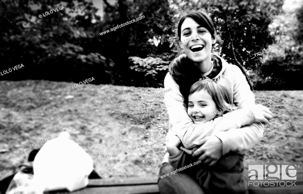 Stock Photo: Mother and daughter laughing.