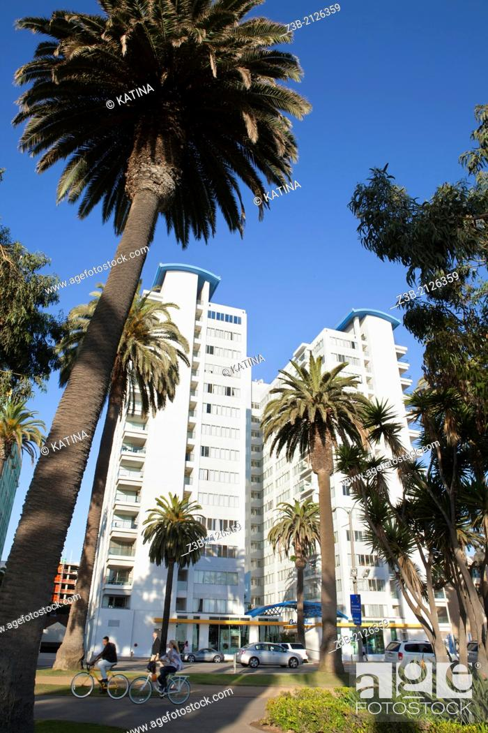 Stock Photo: Vertical view of architecture, palm trees and bikers in Palisades Park, Santa Monica, California, USA.