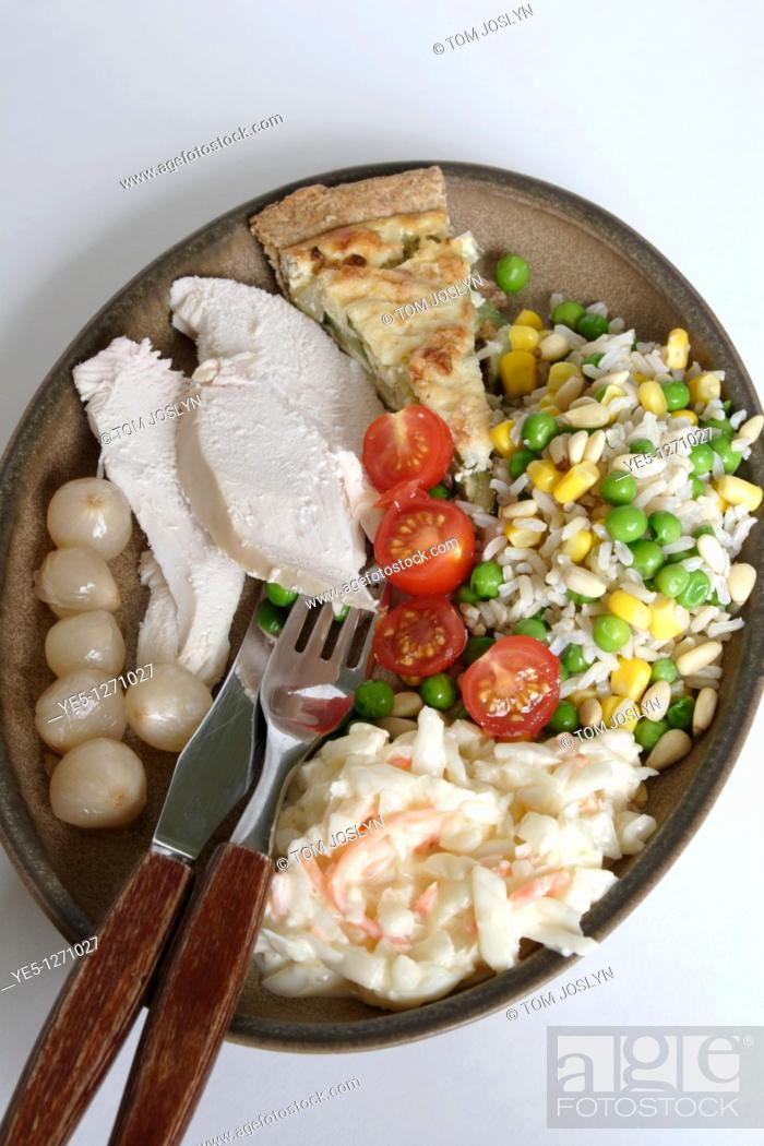 Stock Photo: Selection of food on dinner plate.