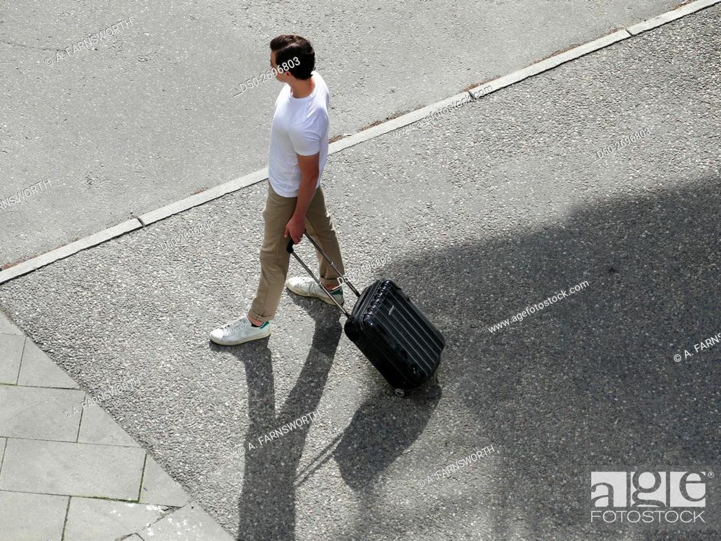 Stock Photo: Walking with suitcase, Stockholm, Sweden.