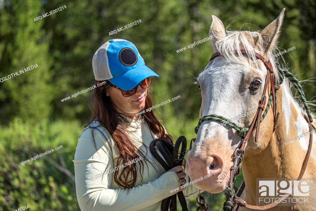 Stock Photo: Close-up Of Smiling Woman With An Horse In Montana.