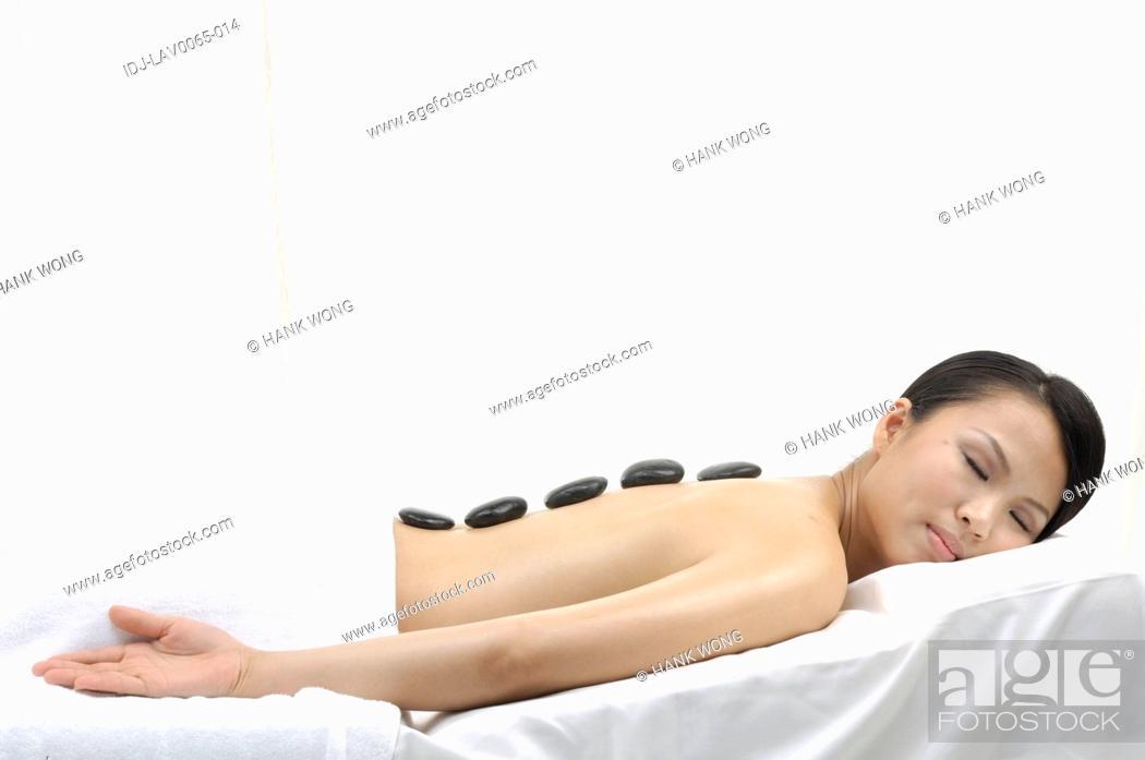 Stock Photo: Woman getting lastone therapy.