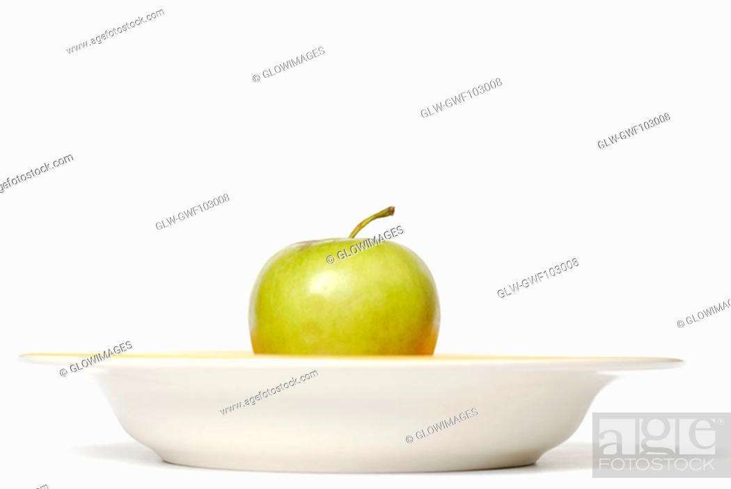 Stock Photo: Close-up of an apple in a bowl.