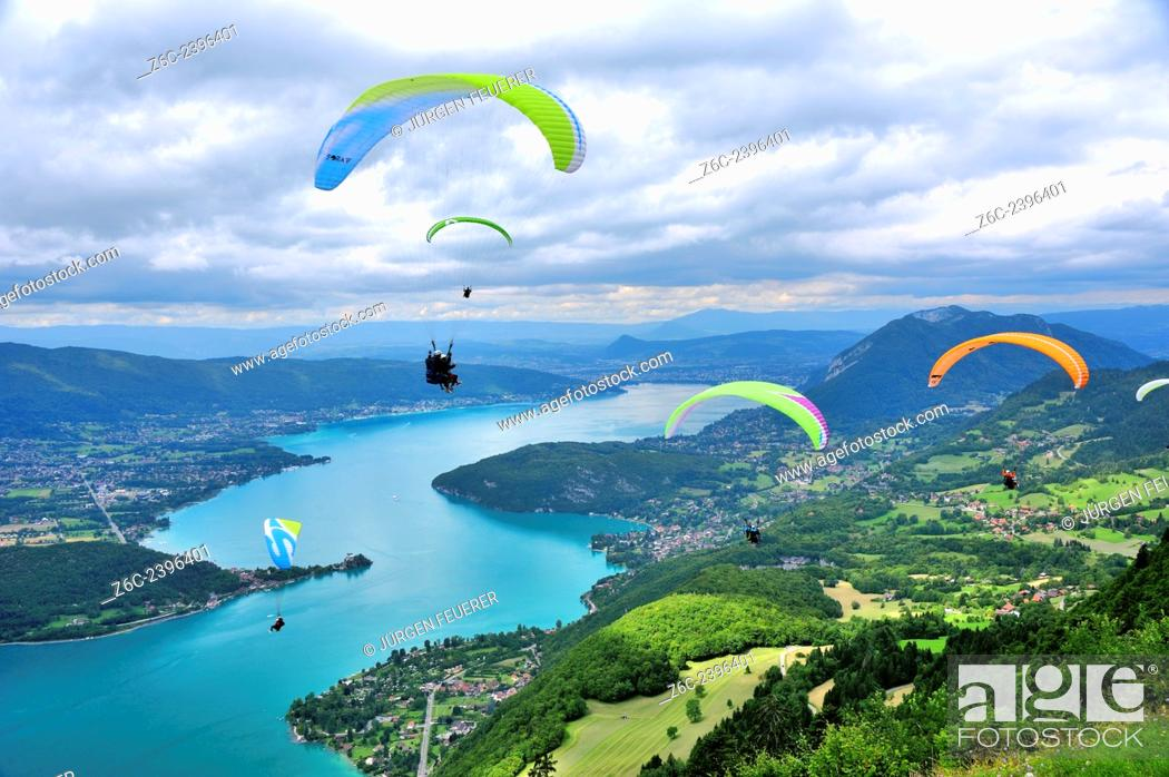 Stock Photo: Paragliders above the lake of Annecy, Haute-Savoie, French Alps, France.