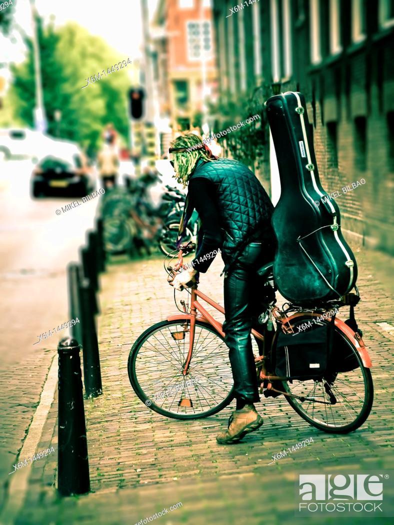 Imagen: musician in a street  Amsterdam, Holland, Netherlands, Europe.