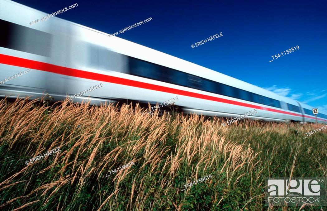 Stock Photo: ICE train traveling on the open road.