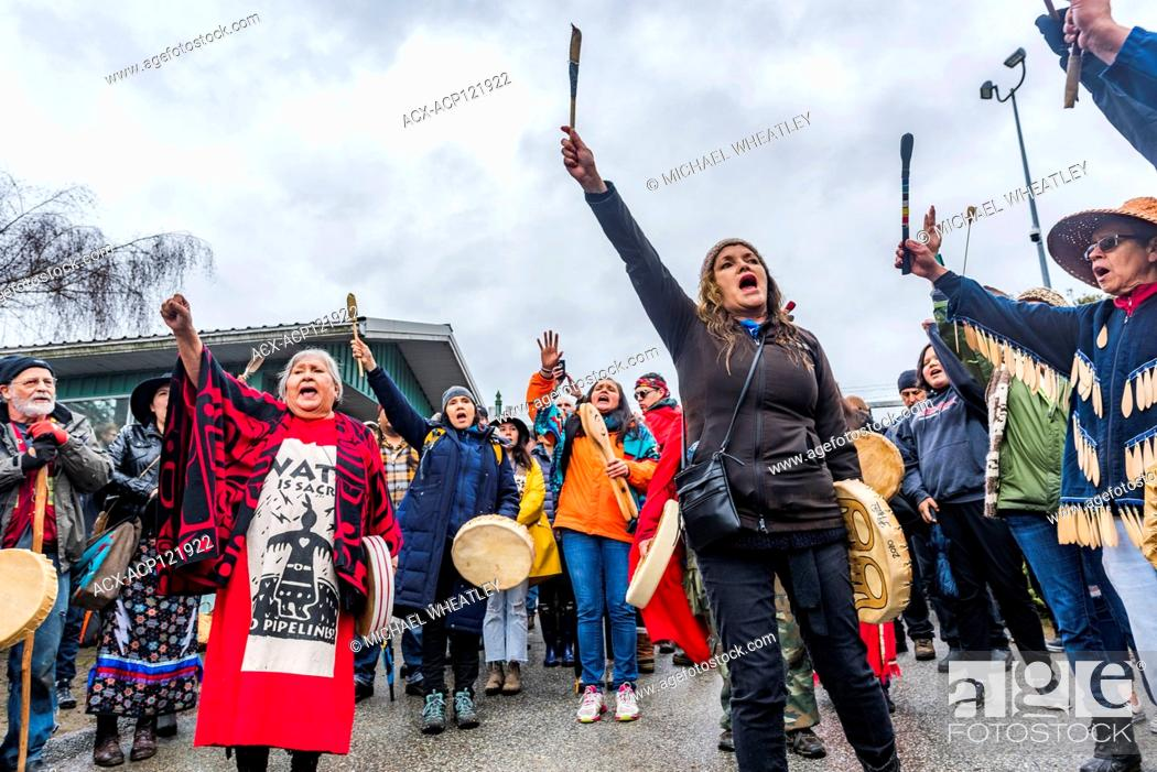Stock Photo: Large group of Indigenous leaders risk arrest at Blockade of Kinder Morgan Pipeline entrance, Burnaby Mountain, Burnaby, British Columbia, Canada.