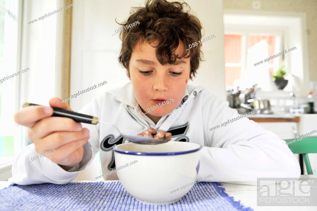 Stock Photo: 10 year old boy eats coco puffs for breakfast, Medevi, Sweden.