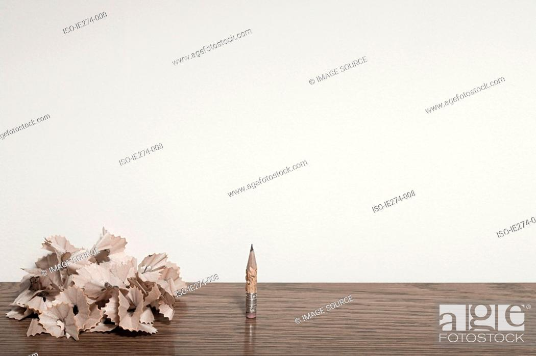 Stock Photo: Chewed pencil and pencil shavings.