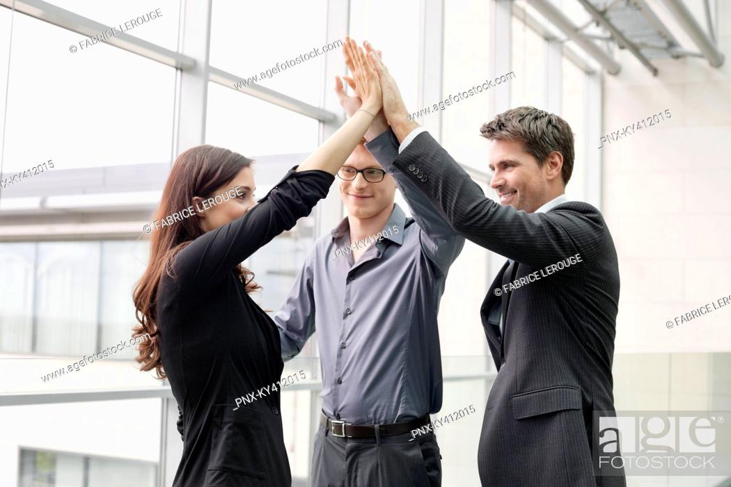 Stock Photo: Business executives giving high-five to each other.