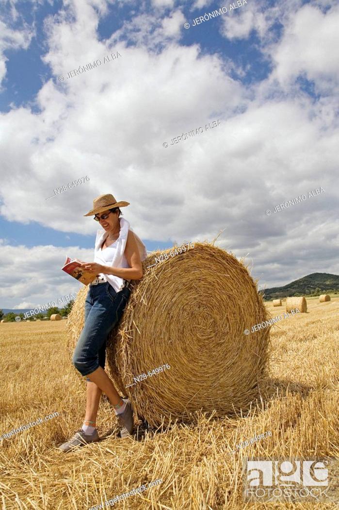 Stock Photo: Woman reading in field. Villarcayo. Burgos province, Castilla-León, Spain.
