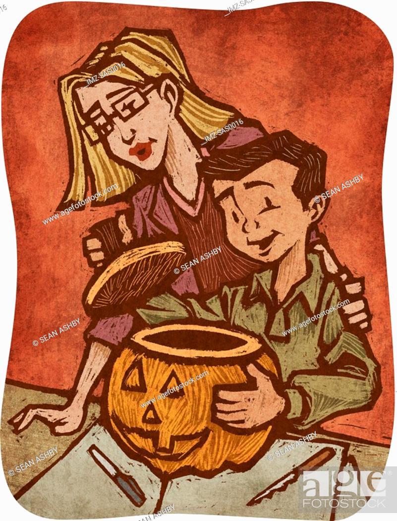 Stock Photo: A woman helping a boy carve a pumpkin.