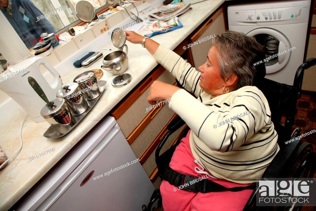 Wheelchair User With Spina Bifida Making Tea Notice The Kitchen