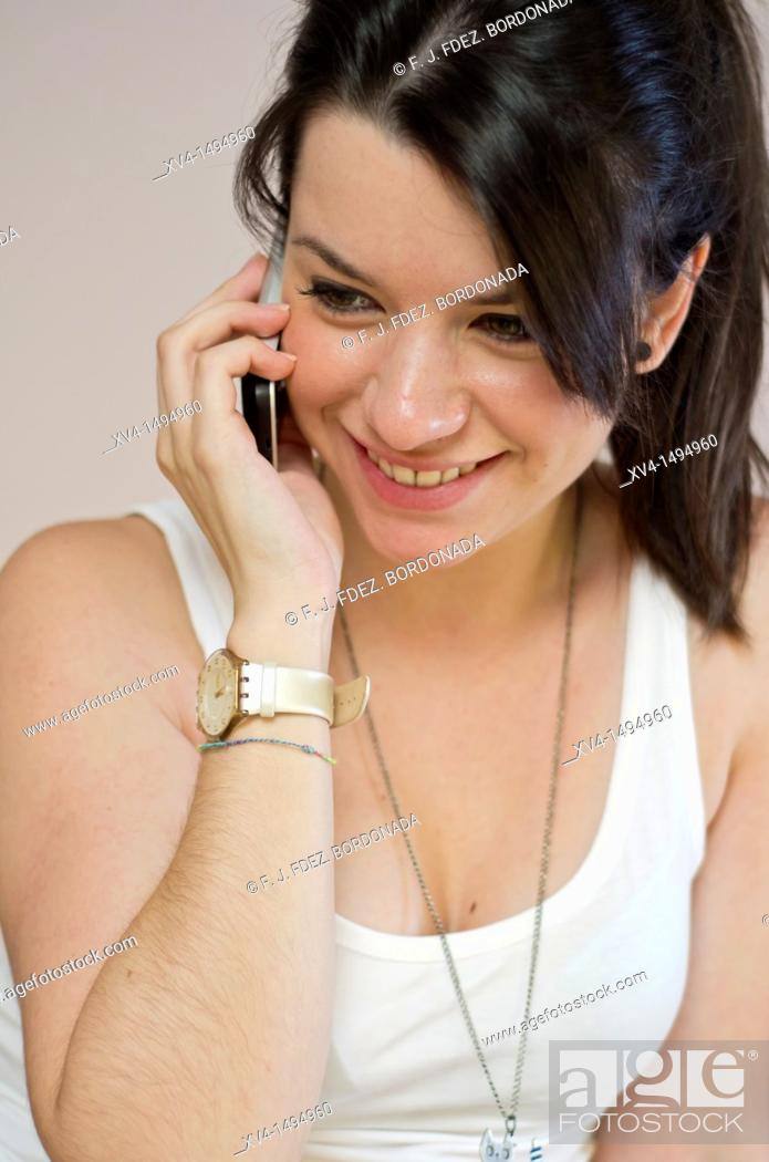 Stock Photo: Teenage girl talking on her mobile phone.