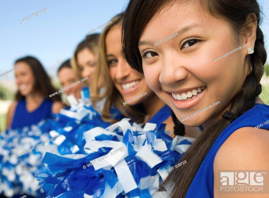 Stock Photo: Cheerleaders sitting on bench portrait.