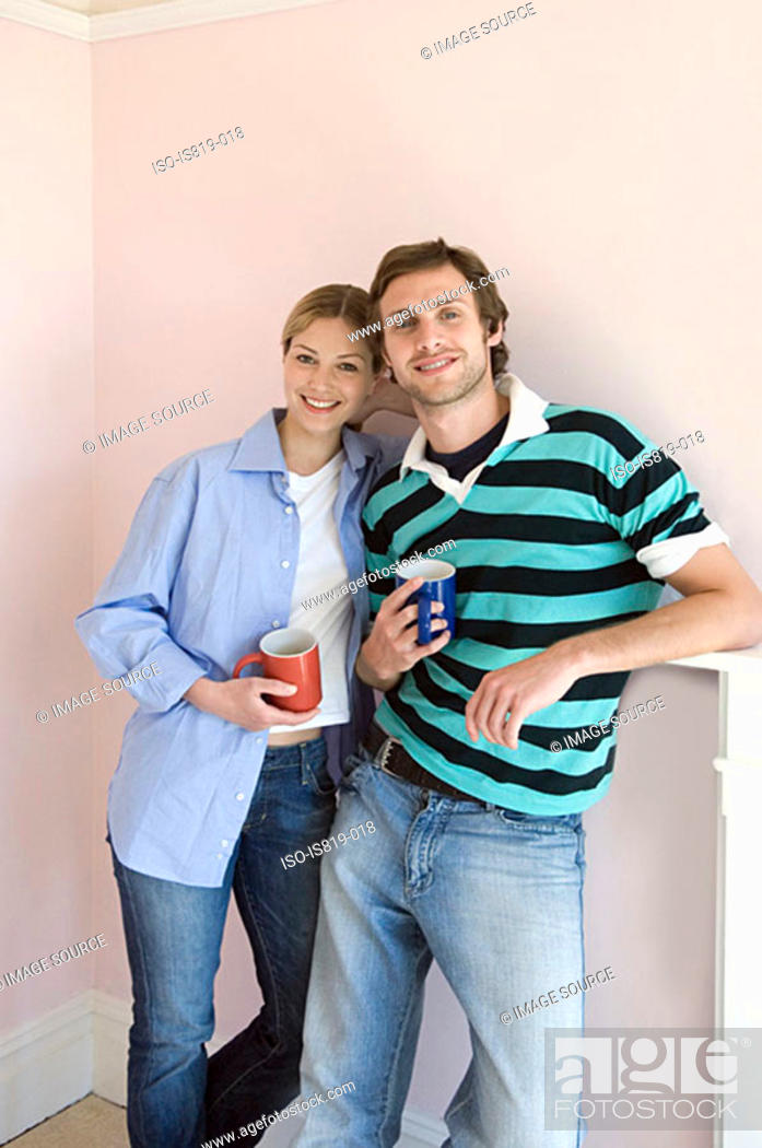 Stock Photo: Young couple with coffee cups.