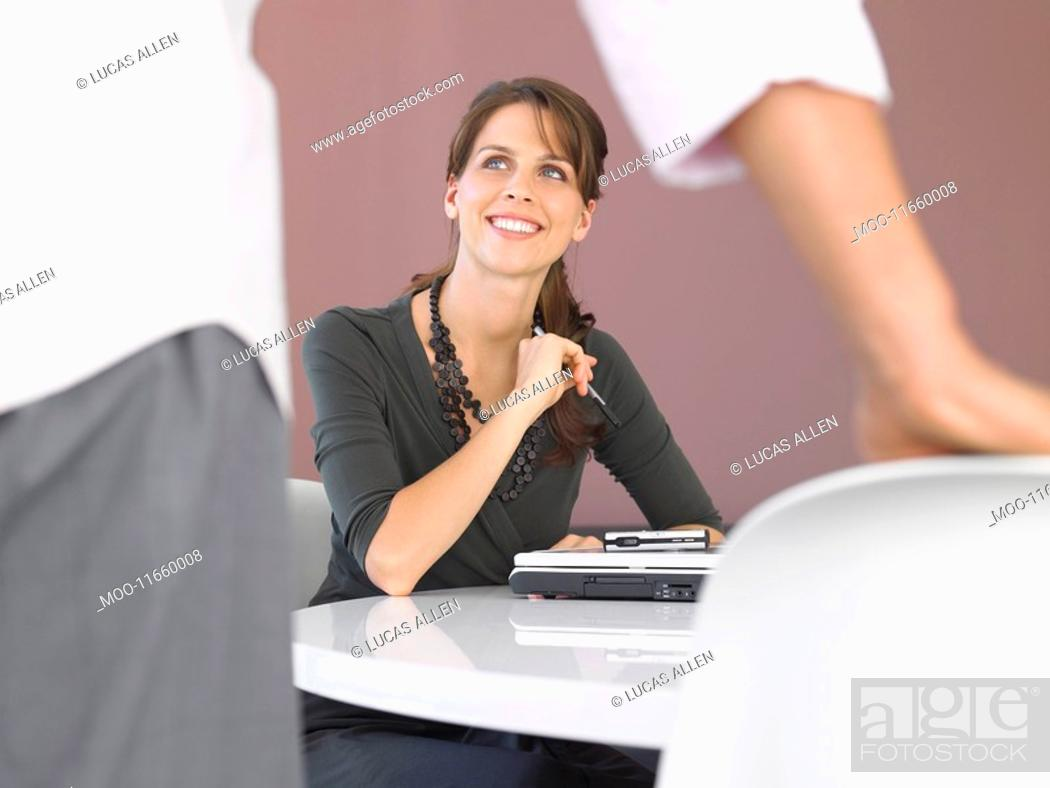 Stock Photo: Businesswoman with laptop at table.