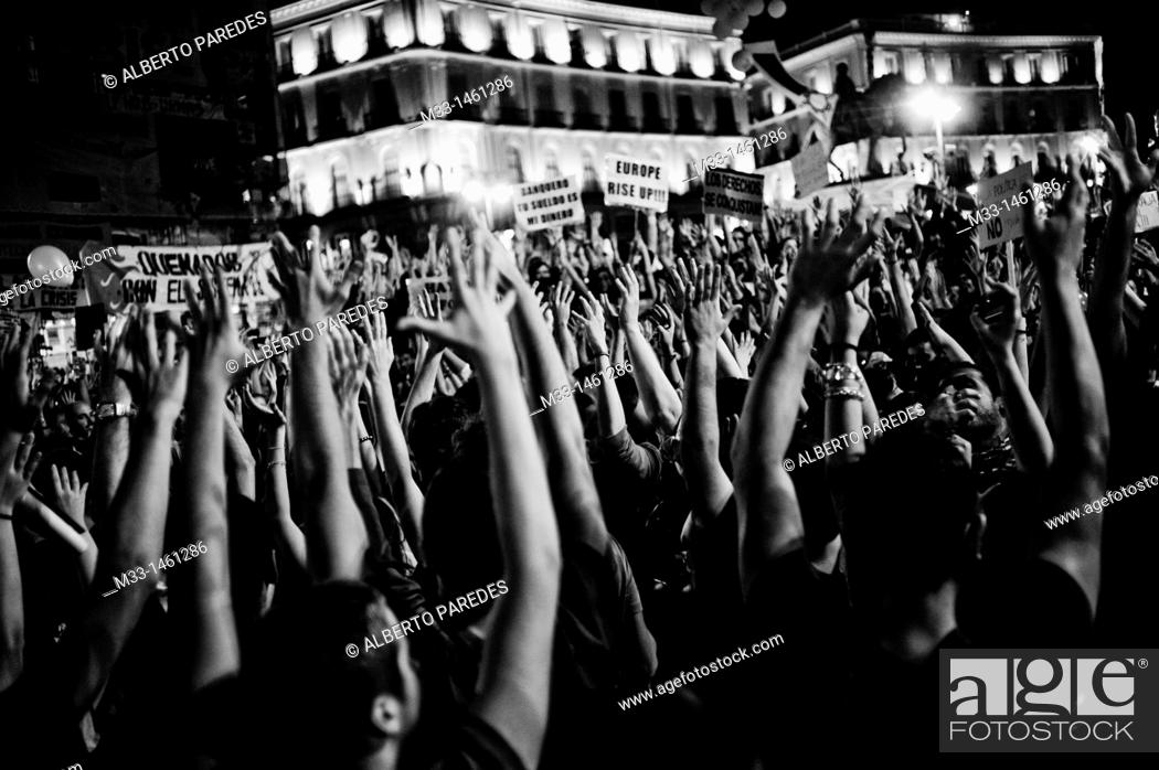 Stock Photo: Spaniards flood Madrid's Puerta del Sol Square on regional and municipal pre-elections demonstrations  The general assembly of Sol was born after a protest in.