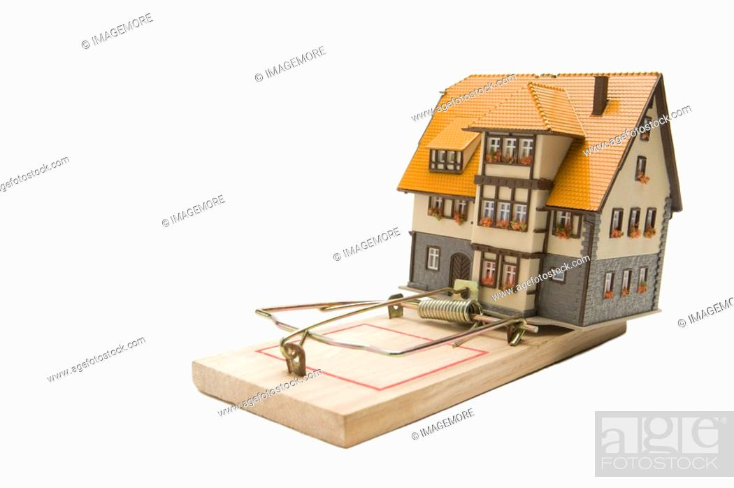Stock Photo: A house model on a mousetrap.