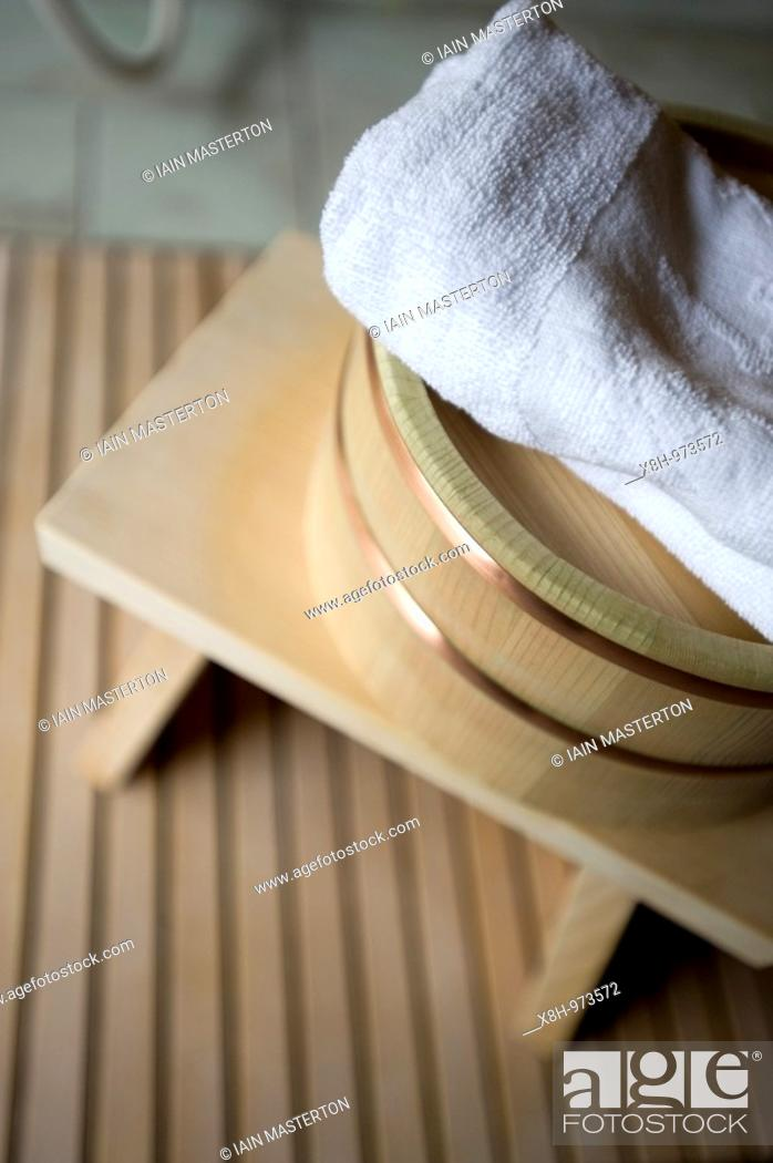 Stock Photo: Detail of traditional wooden stool, basin and towel in Japanese bathhouse.