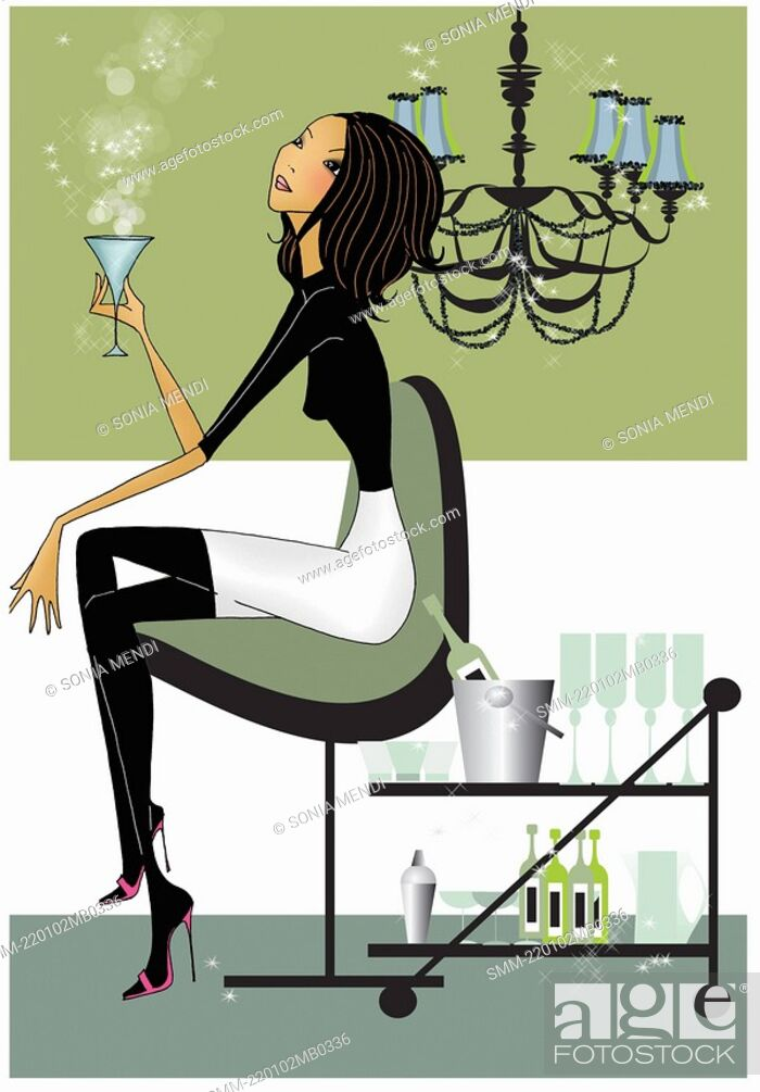 Stock Photo: Woman sitting in a modern chair with a cocktail.