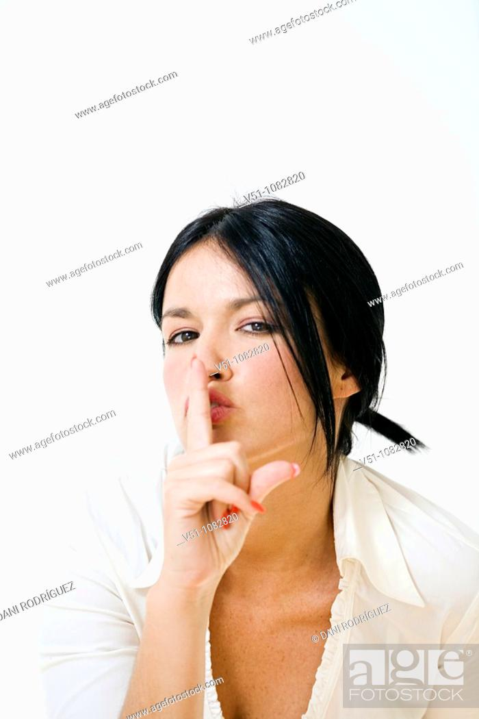 Stock Photo: Portrait of a brunette woman asking for silence.
