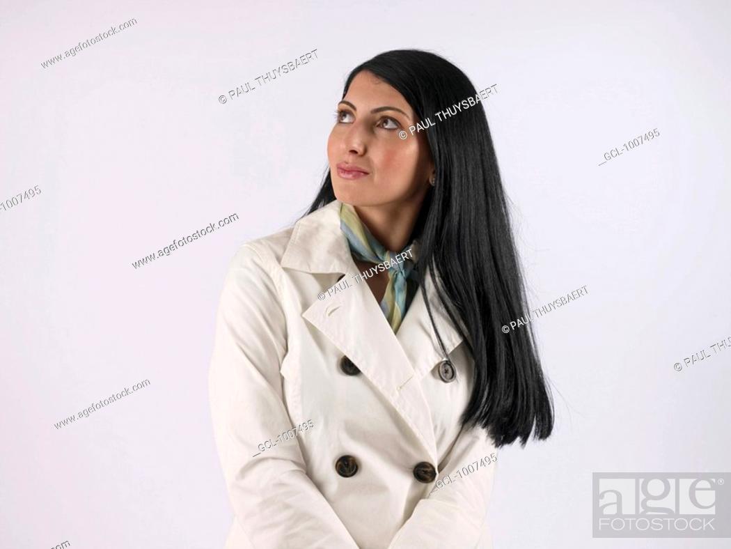 Stock Photo: Woman wearing white coat.