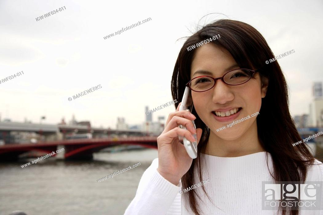 Stock Photo: Close-up of a young woman using mobile phone.