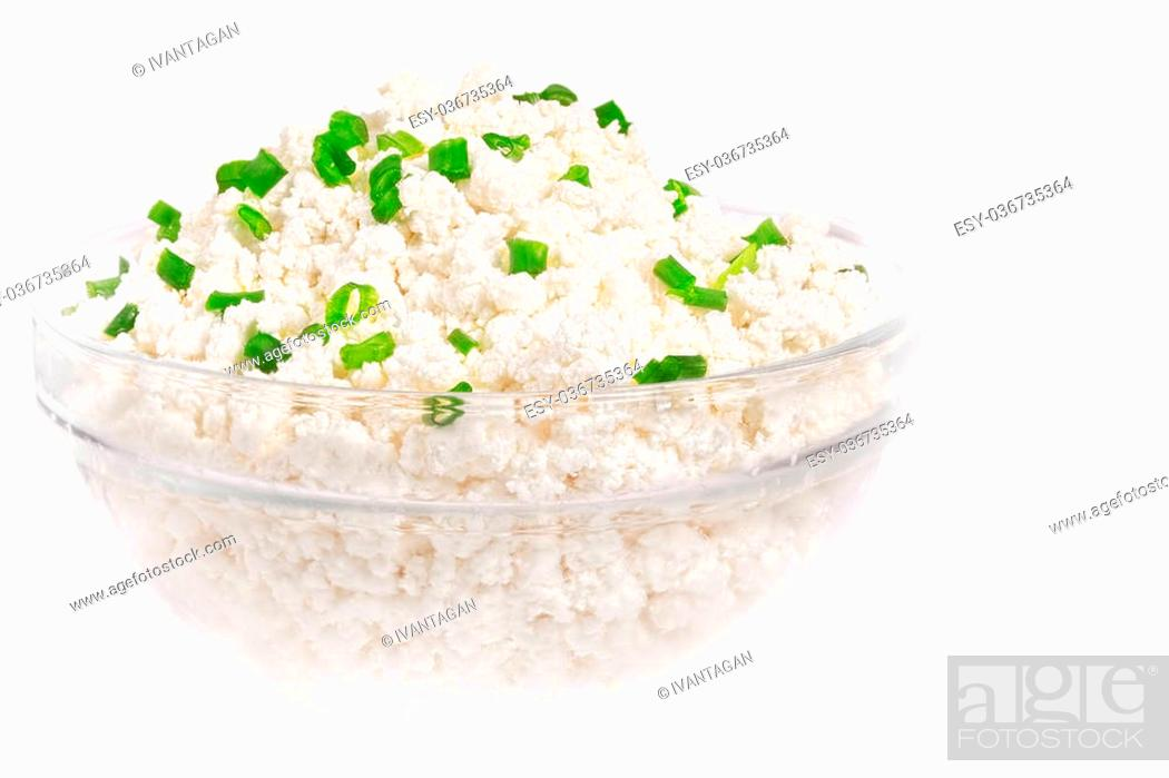 Stock Photo: Fresh cottage cheese (curd) in glass bow, isolated on white background.