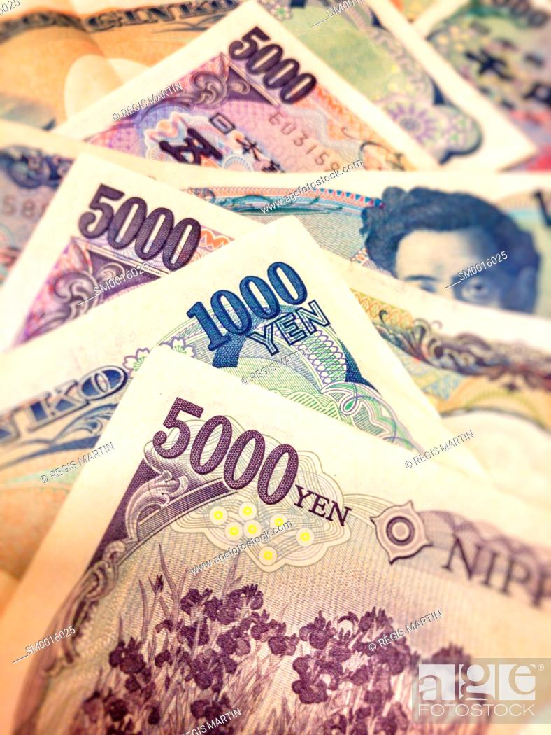 Stock Photo: closeup of Japanese bank notes, the Japanese currency is called the Yen.