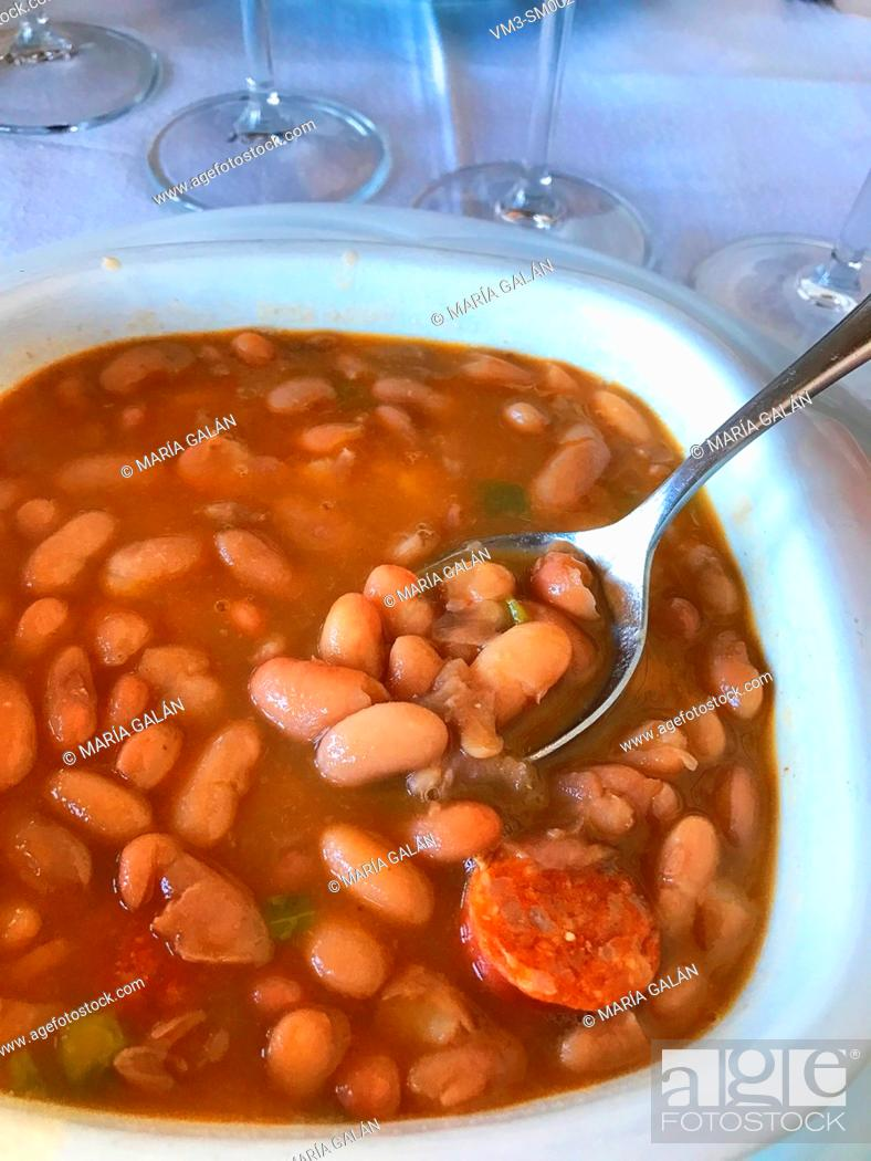 Stock Photo: Eating beans stew.