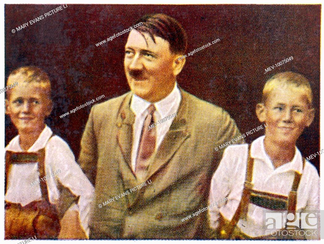 Stock Photo: ADOLF HITLER Relaxing with two young friends, circa 1933.