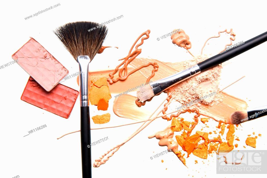 Stock Photo: Powder foundation and makeup brush.