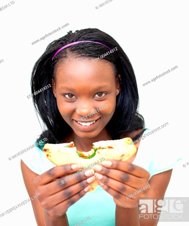 Stock Photo: Joyful young woman eating a sandwich.