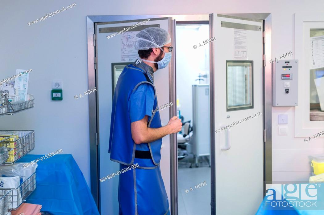Stock Photo: Reportage in the interventional scanner service in Pasteur 2 Hospital, Nice, France. Vertebroplasty- cementoplasty operation to treat a vertebral facture.