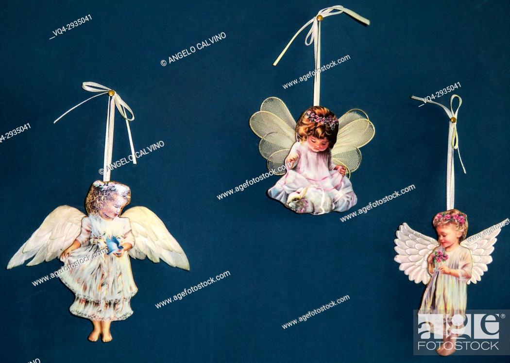 Stock Photo: Close up of Puttos hanging on walls in a gift shop in Rome, Italy.