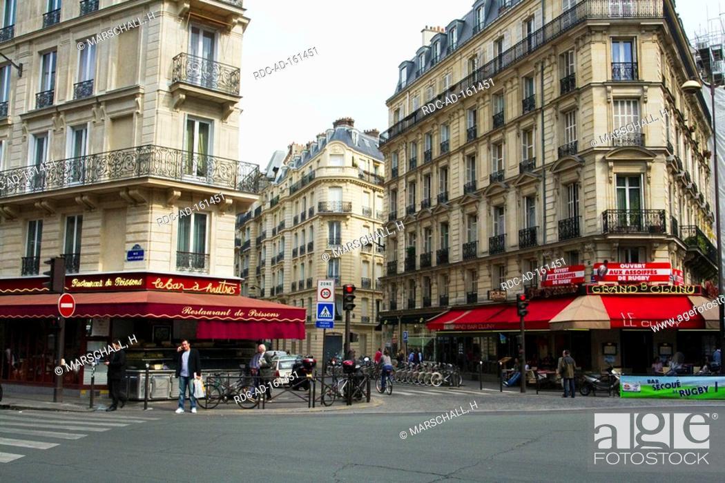 Shopping area corner houses Paris France Quartier de Saint